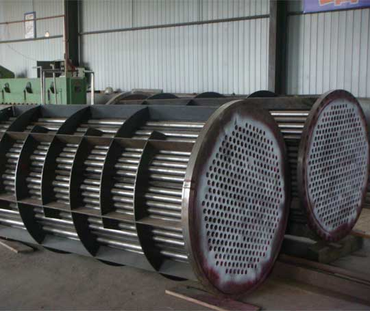 Titanium tube and shell heat exchanger